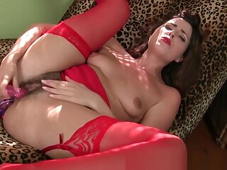 American milf Helena fills her holes not far from sex toys