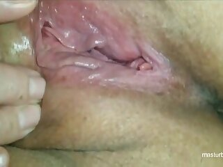 Horny Miss Lonelyhearts Suzanne strokes pussy at home