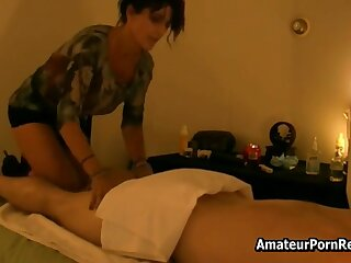 Hot black-hearted gives erotic massage to wonted customer
