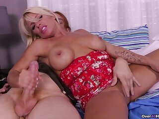 Super blonde pornstar Gina West takes a hard dick in her hands