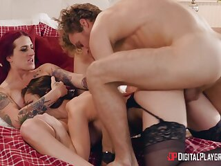 Aroused women share a chunky dick in energized threesome