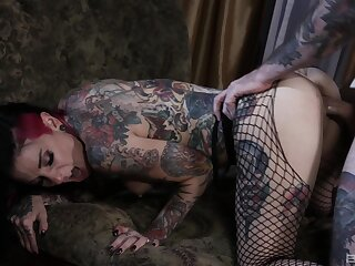 Tattooed couple having hellacious sex on the bed beside facial fulfilling
