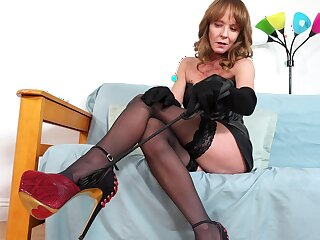 Perverted curvy MILF in black stuff and stockings Cyndi Sinclair goes solo