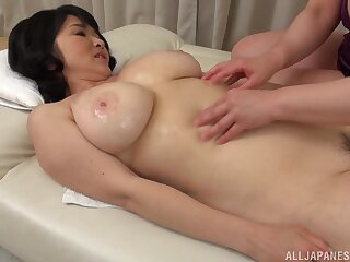 Mizuno Yoshie gives a kneading to a chubby Asian chick with the addition of licks her pussy